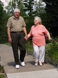 Erderly Holding Hands While Walking